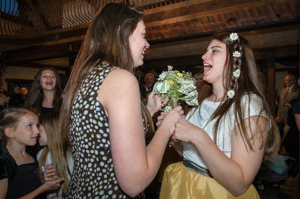Try adding some cold, hard cash to your toss-away bouquet for more participation in the bouquet toss.
