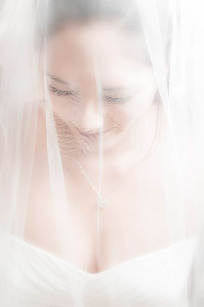 A bride wears a traditional veil for her wedding.