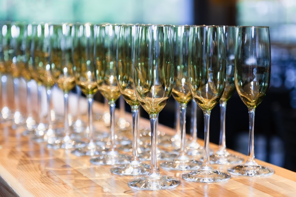 Empty long-stem flutes ready to be filled with white wine or champagne.