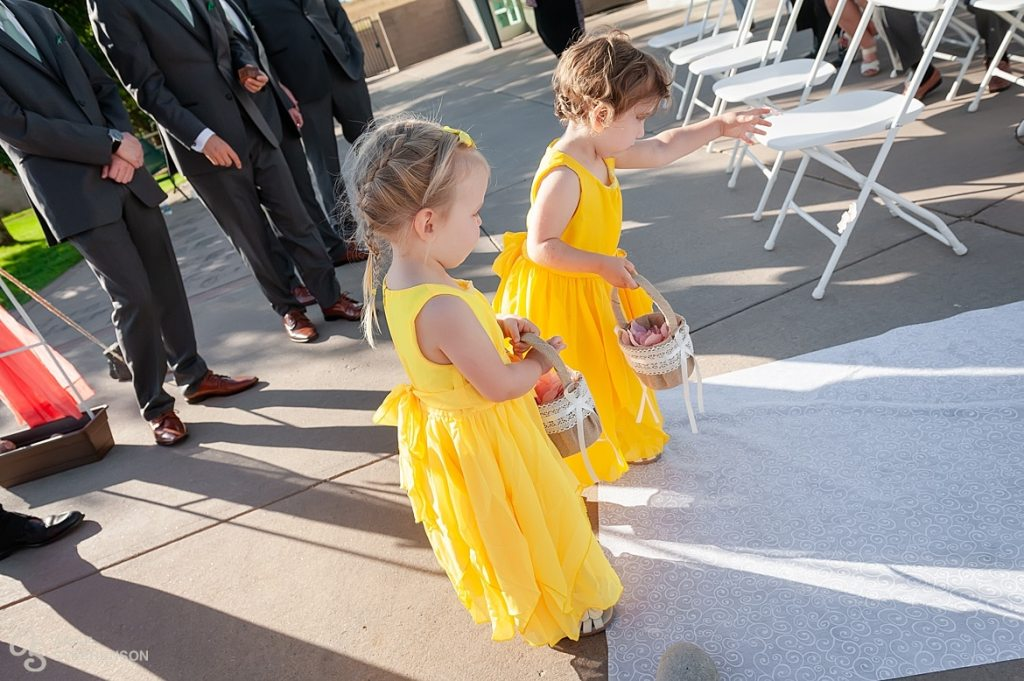 The flower girls remembered they didn't drop petals down the aisle so they turned around and started back down the aisle to make amends.