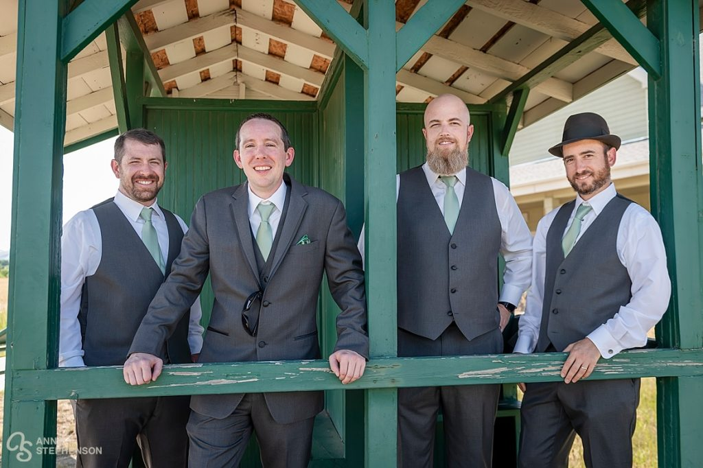 The groom and groomsmen at an old station building at the Lakewood Heritage Center.