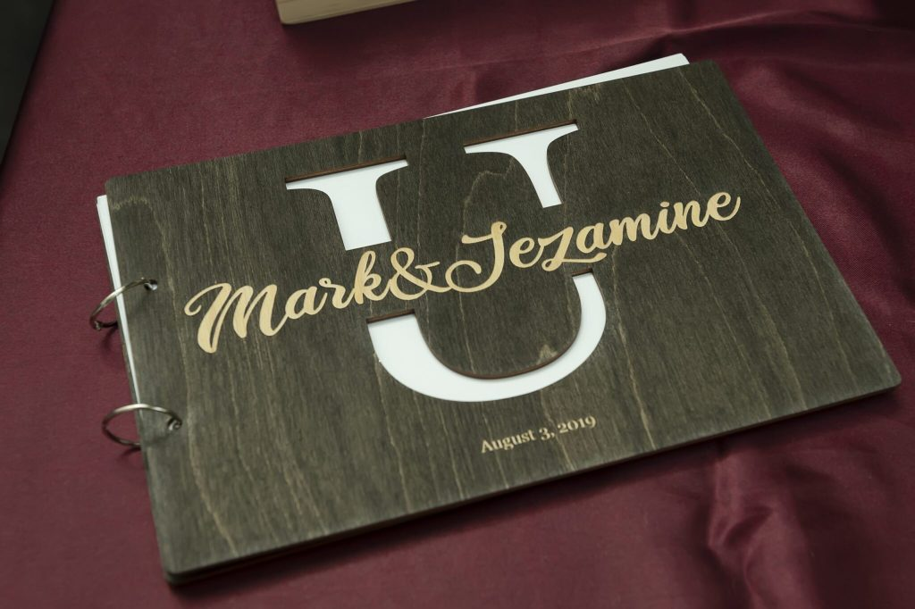 A custom-made guest book with a monogram of their last name.