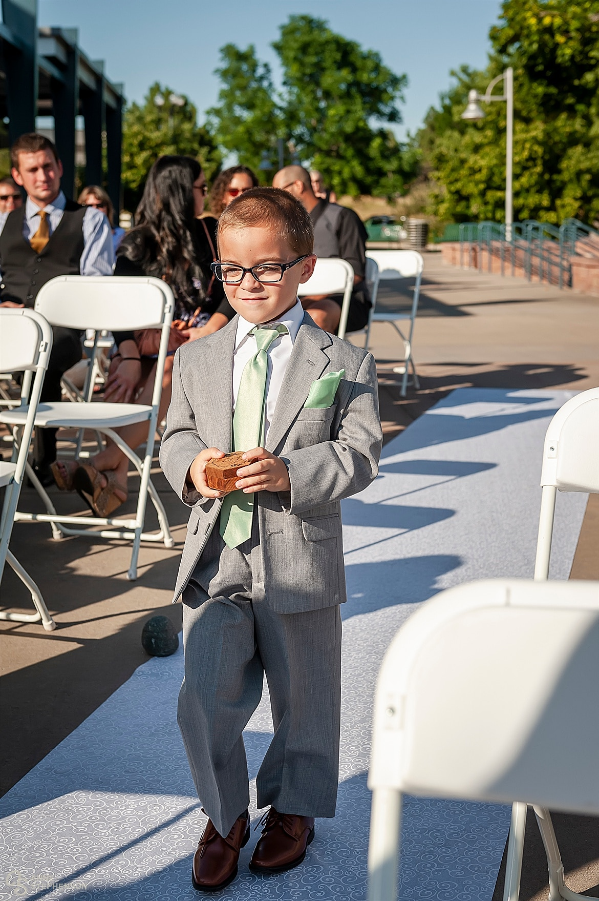 The ring bearer proceeds down the aisle.