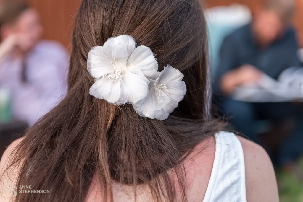 The bride wore flowers in her hair from her mother's own wedding dress.