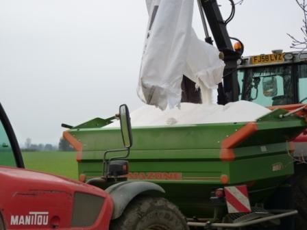 loading the fertiliser spreader ready to spread fertiliser on wheat in the spring