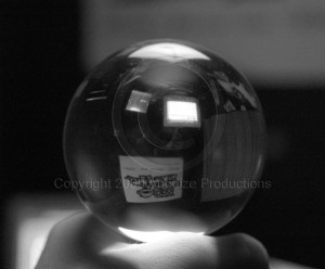 Crystal ball showing deceptive images