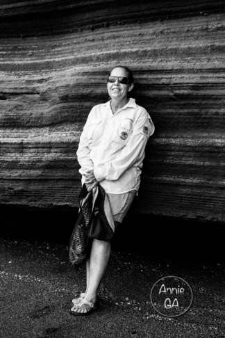 Silvia Varga, naturalist, guide, first aider, liaison officer and general tourist babysitter extraordinaire, leaning against the volcanic ash rock at Puerto Egas, Santiago.