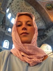 Inside the mosque. Headscarf. Full length zip up cover made from hospital scrubs material. Covered. Completely.