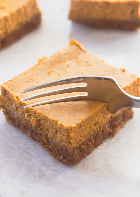 Pumpkin Cheesecake Bars with Biscoff Cookie Crust - These Pumpkin Cheesecake Bars have a sweet, spicy, soft filling and are married with the most amazing Biscoff Cookie Crust!