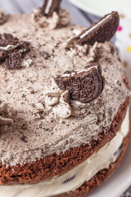 """My """"Naked"""" Oreo Lover's Cake is one decadent, delicious dessert! Super simple to make, it looks like it took you hours to perfect those rich, chocolate cakes, crunchy Oreo centre and perfectly smooth whipped cream frosting."""