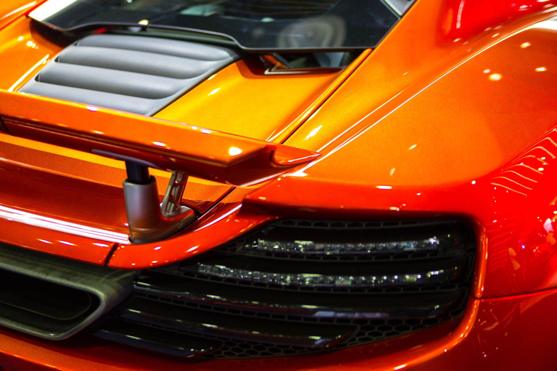 Ombre Orange McLaren Luxury Car at Detroit's North American International Auto Show Press Preview Day NAIAS 2019 by Annie Fairfax