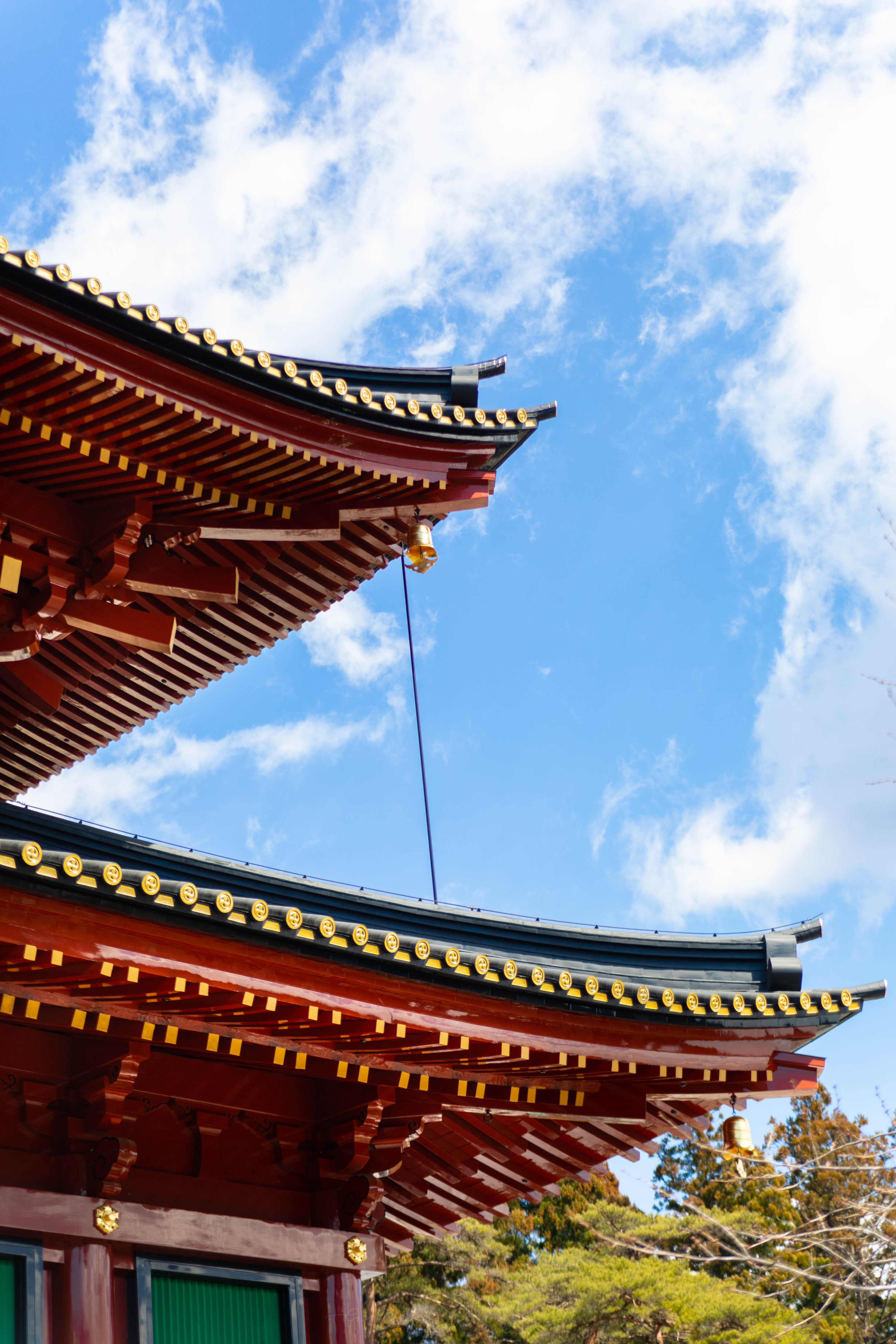 Red Pagoda of Rinnō-ji Buddhist Temple Against a Blue Sky in Nikko, Japan, the Ultimate Travel Guide Written, Researched, and Photographed by Travel Writer & Photographer Annie Fairfax