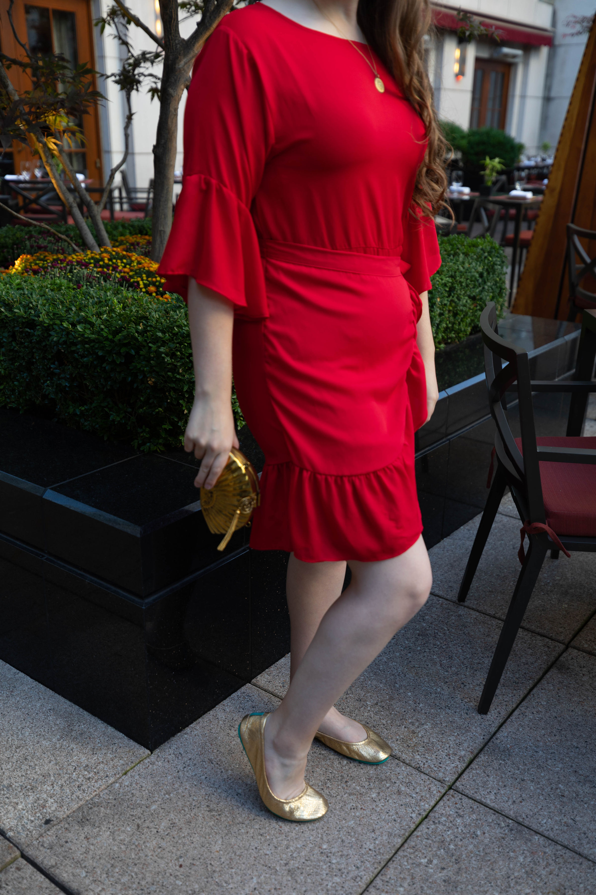 Red Dress and Golden Metal Fan Handbag by From St. Xavier at the Peninsula Hotel Chicago Midwest Travel Ideas Outfit Ideas Golden Glitz Tieks