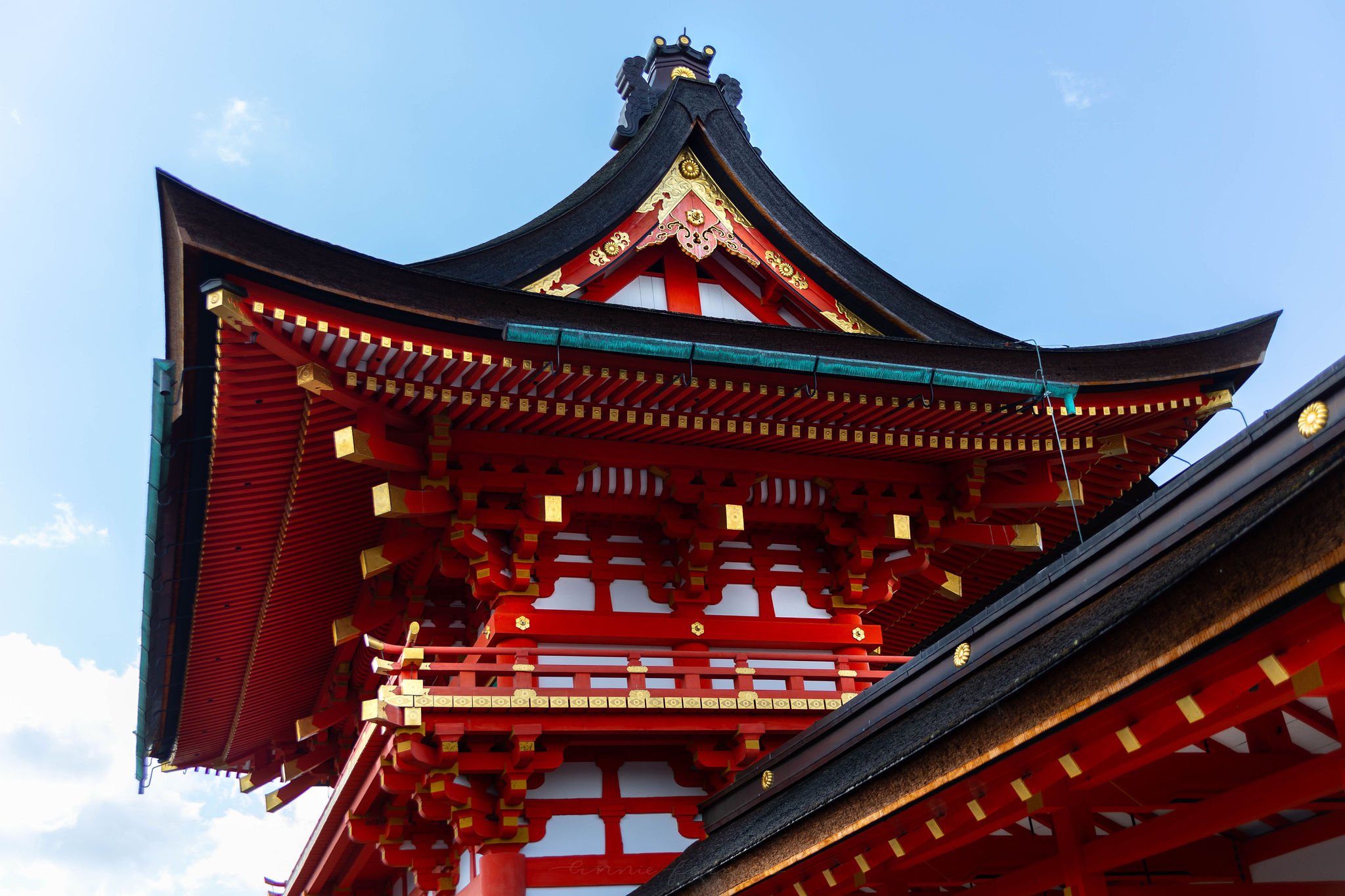 Main Shrine at Fushimi Inari Taisha Shrine 10,000 Red Vermillion Torii Gates in Kyoto Japan Mt. Inari Hiking Path