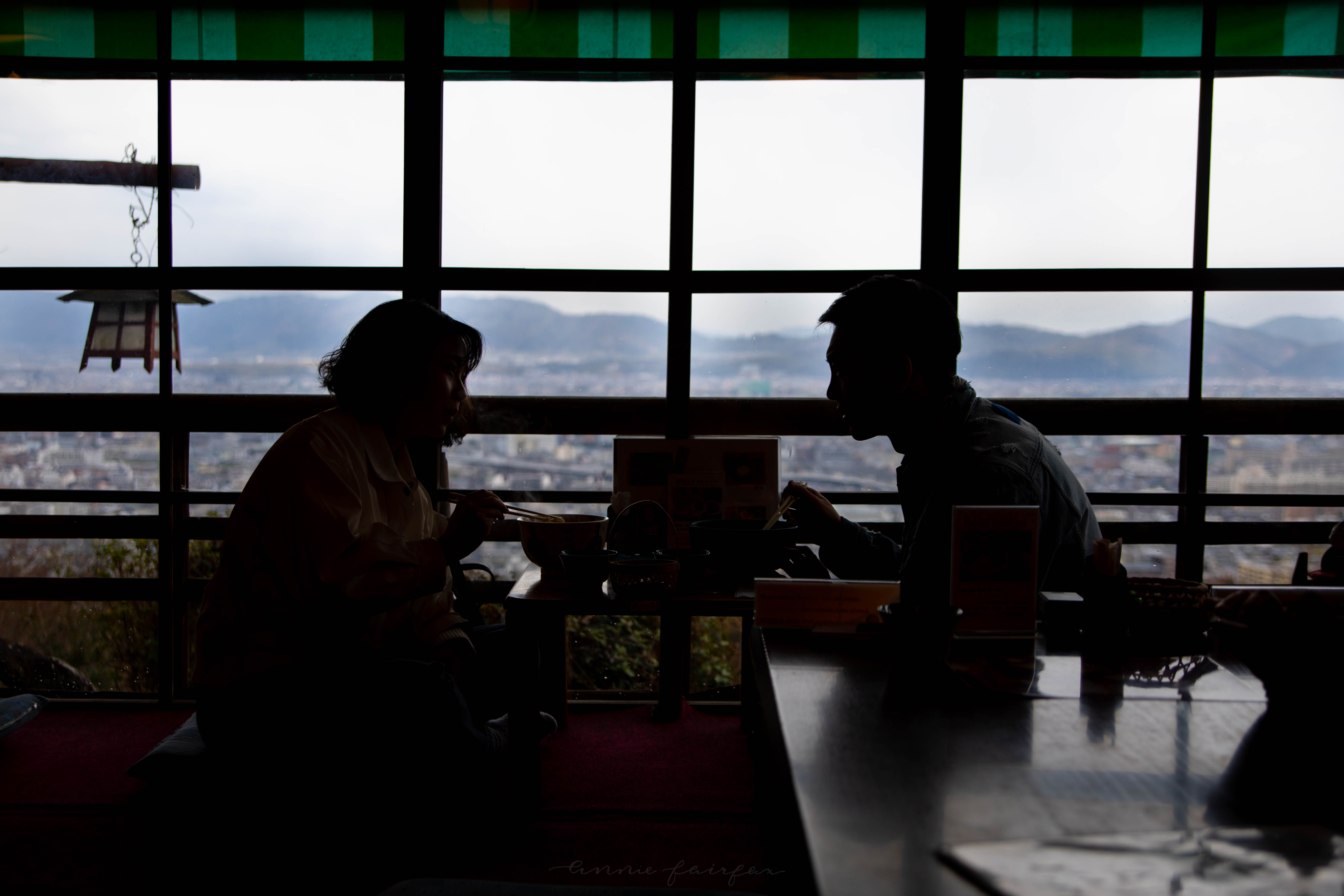 Silhouette of Couple Eating Udon at Fushimi Inari Shrine in Kyoto Japan