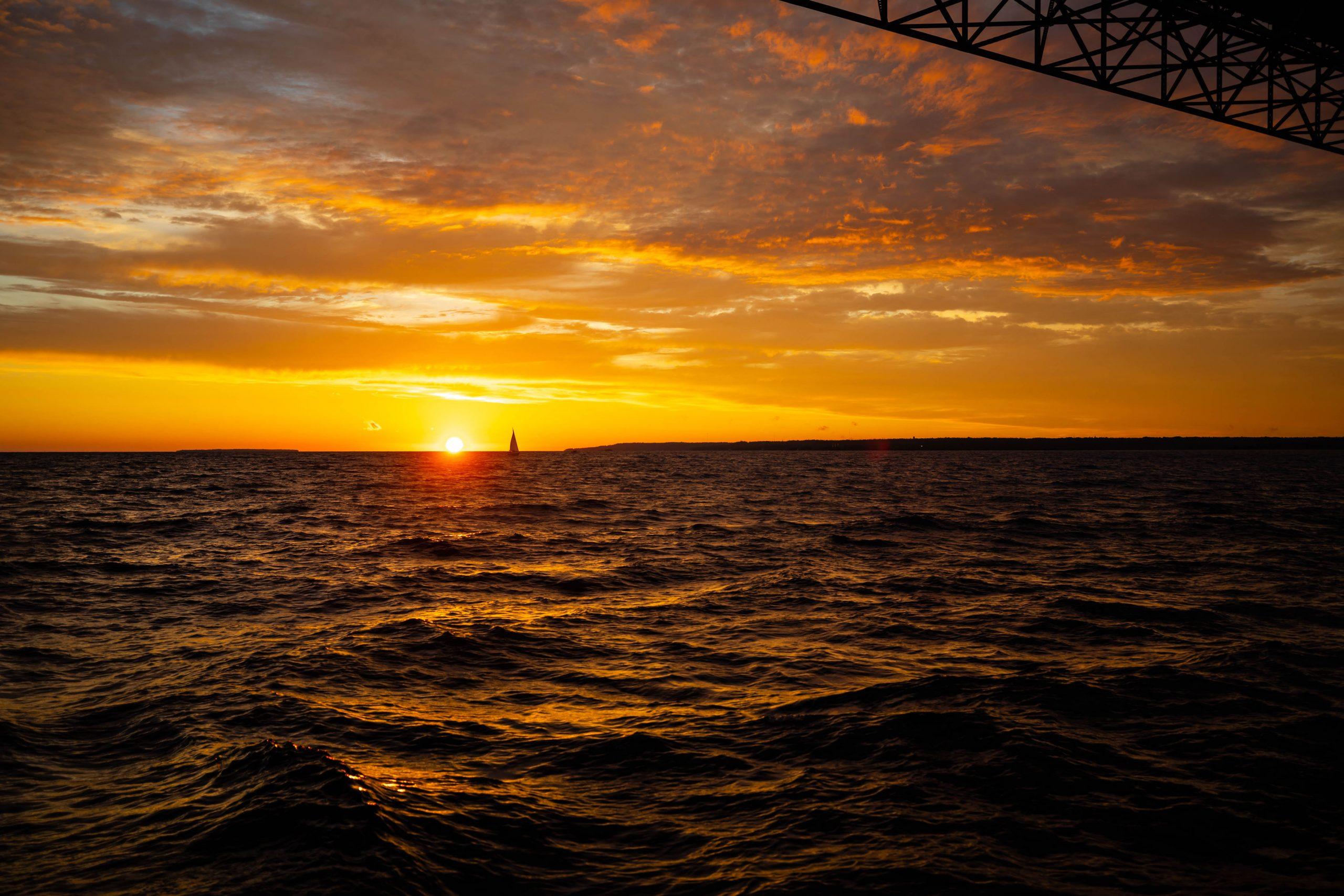 Mackinac Bridge Sailboat Sailing the Straits of Mackinac at Sunset Pure Michigan Up North by Annie Fairfax