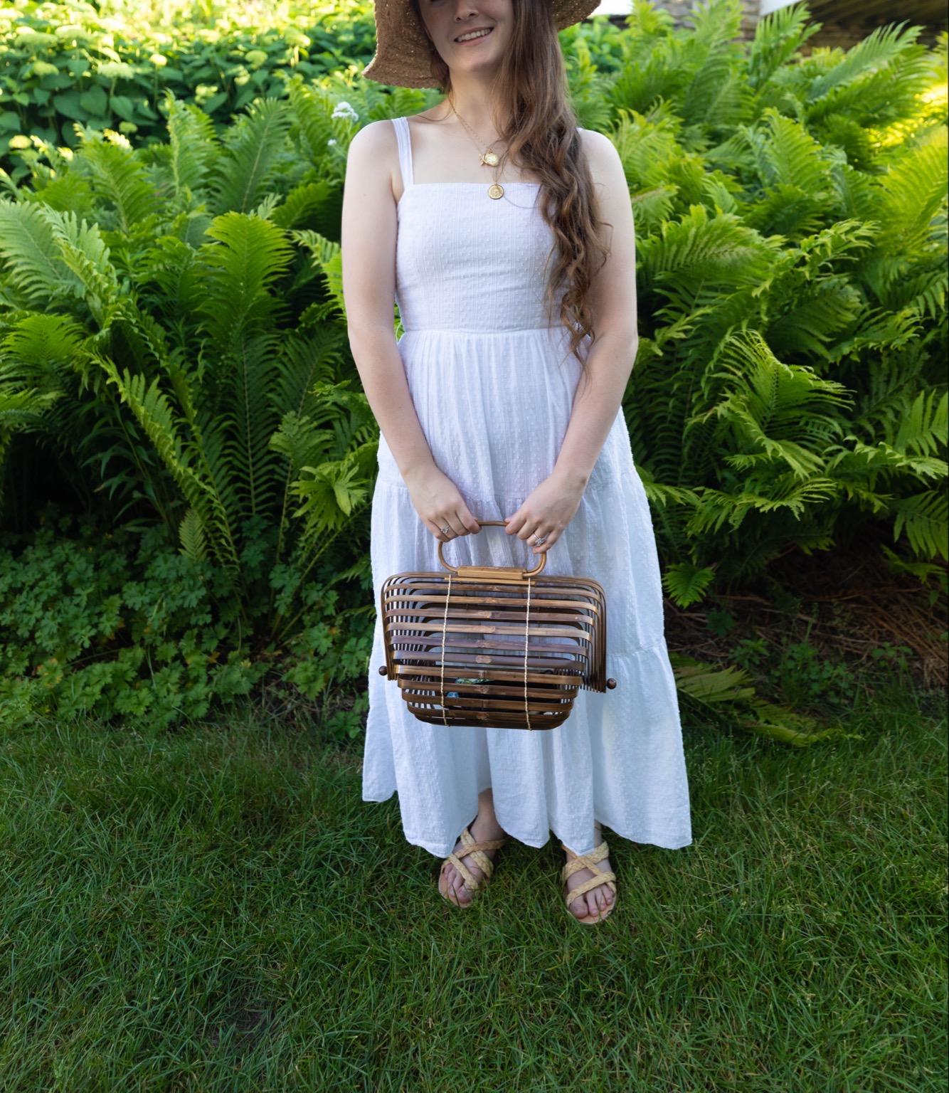 A Breezy White Swiss Dot Duffield Lane Maxi Dress Cult Gaia Basket Bag Wooden Shell Earring by Annie Fairfax