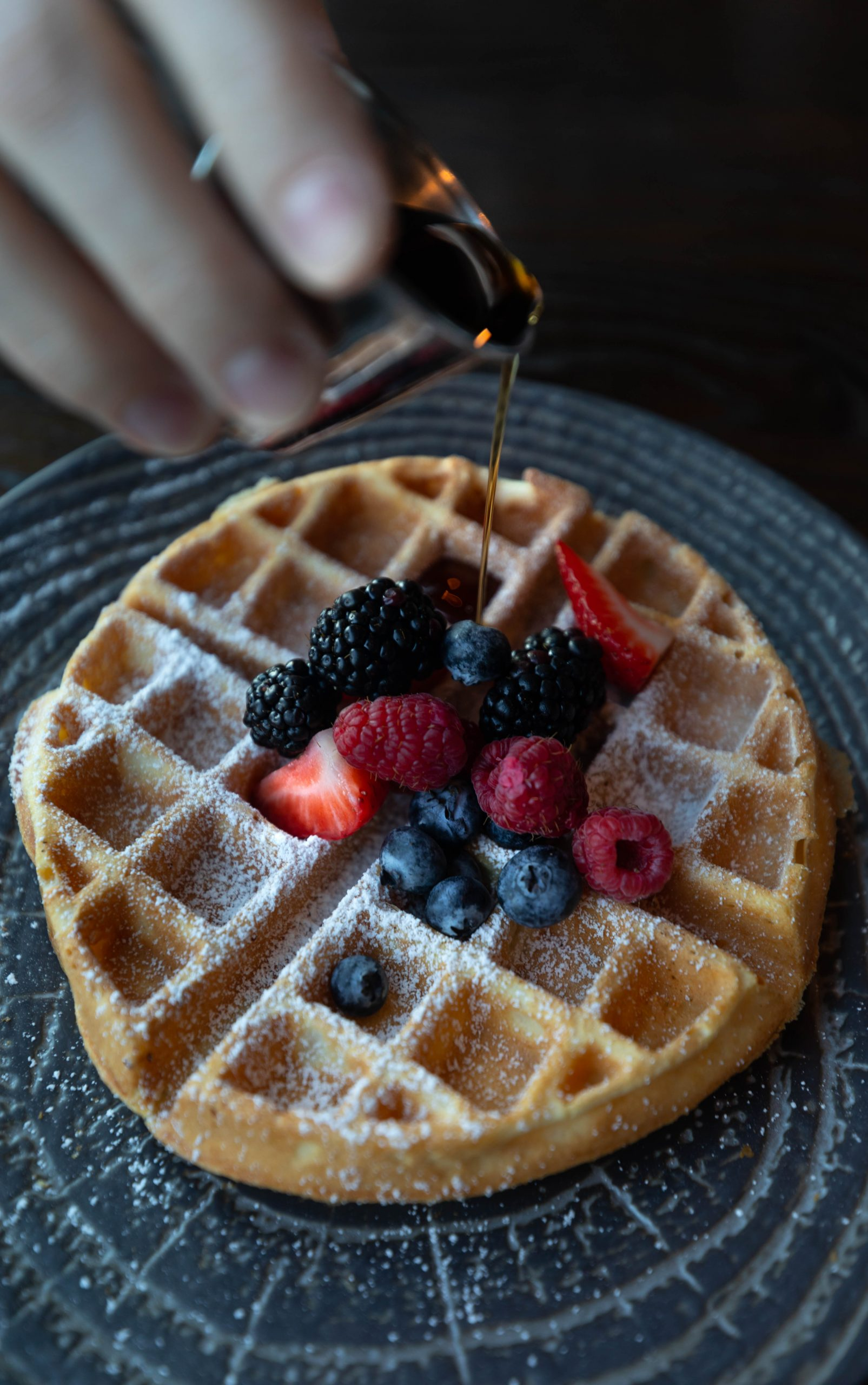 Goldfinch Tavern Belgian Waffle Topped with Fresh Fruit Seasonal Berries and Maple Syrup at Four Seasons Hotel Seattle Washington by Annie Fairfax