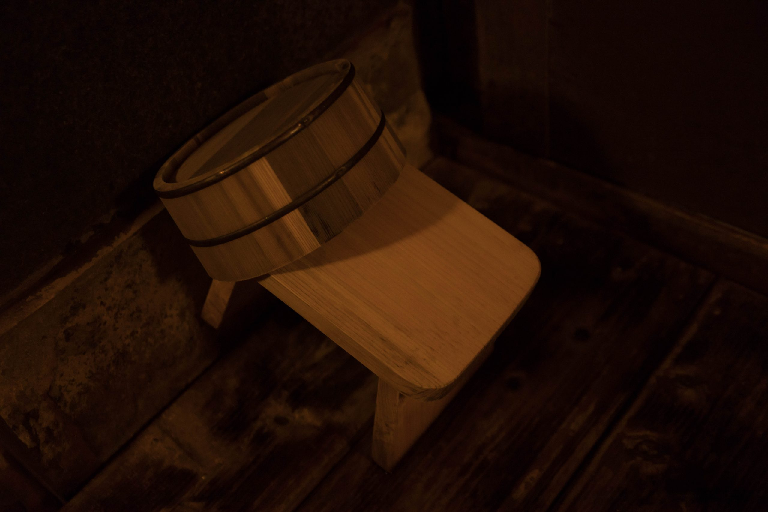 Bucket and bench Family Bath Onsen Hot Springs Etiquette in Japan by Annie Fairfax