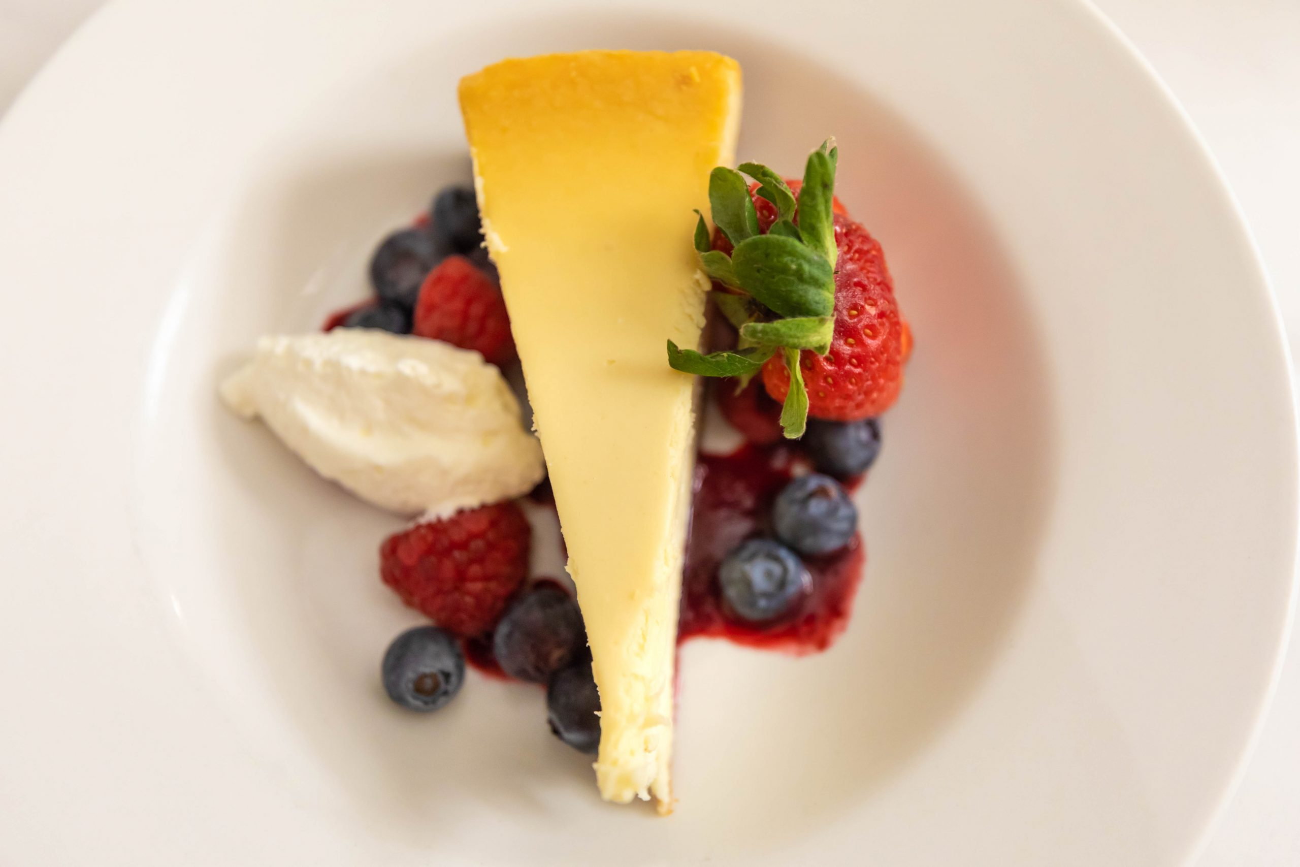 New York Cheese Cake Aerie Restaurant at Grand Traverse Resort & Spa in Acme Traverse City Michigan Photographed by Annie Fairfax Vanilla Fresh Berries