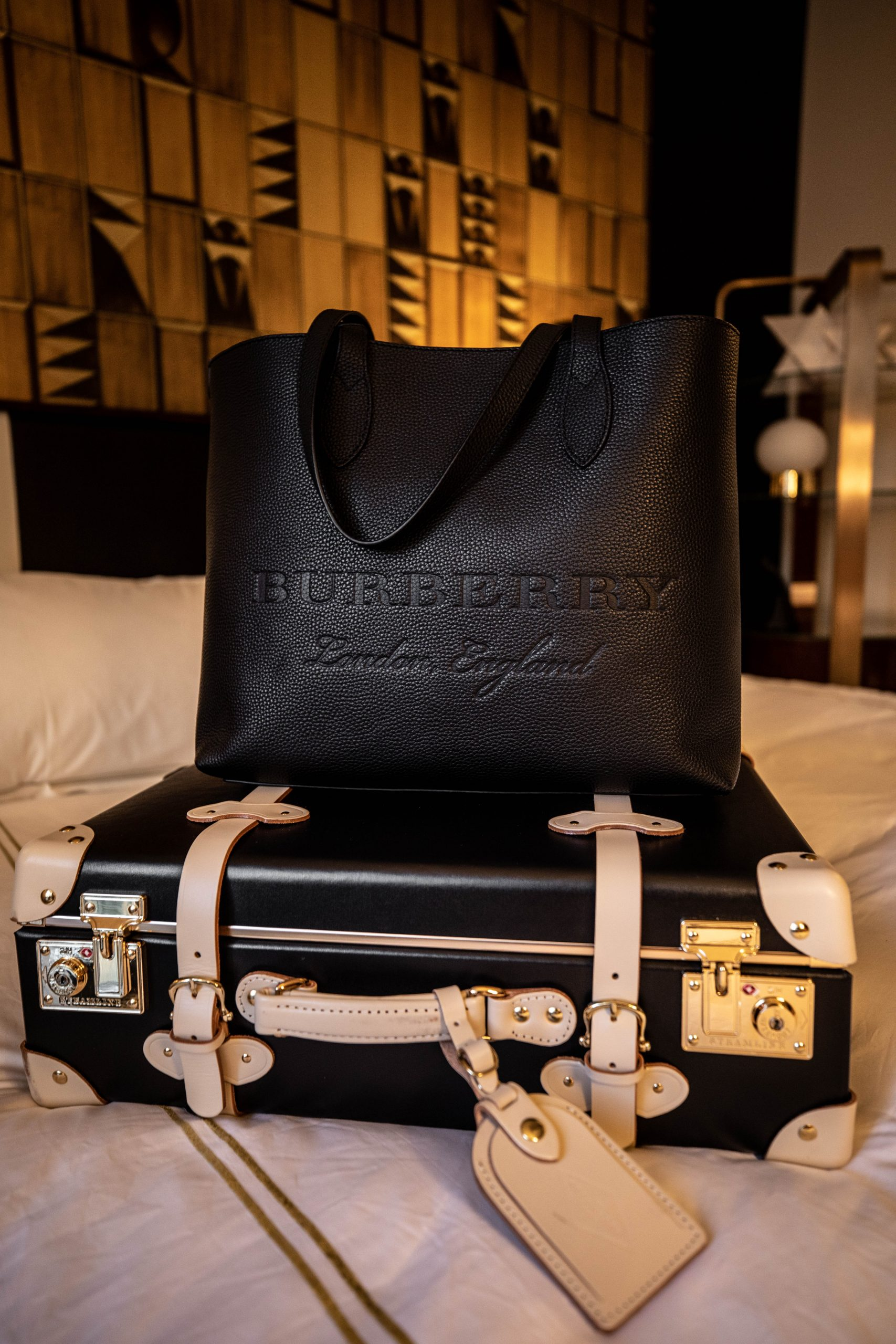 Steamline Luggage at Viceroy Chicago Hotel with Burberry Leather Tote Bag by Annie Fairfax