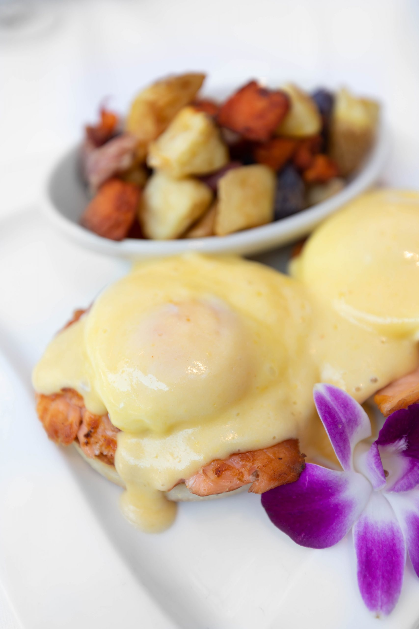 Smoked Salmon Eggs Benedict at Palmetto Café Inside Belmond Charleston Place Luxury Hotel Written & Photographed by Annie Fairfax