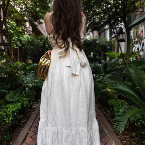 Golden Greek Goddess-inspired Look Cara Cara White Linen Dress and Golden Greek Goddess Coin Barette by Lelet New York Cult Gaia Gold Ark Bag Styled by Annie Fairfax