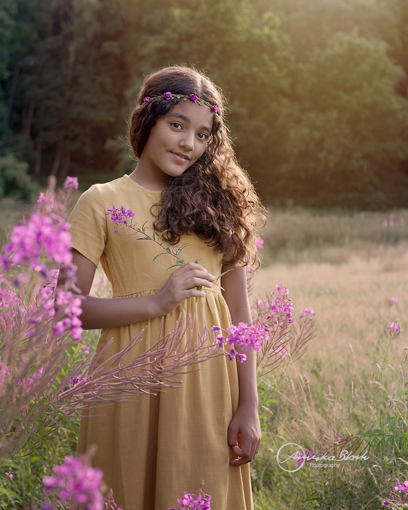 Fine art child portrait photography, girl surrounded by nature