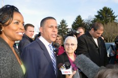 Former Democratic gubernatorial candidate Anthony Brown and his wife, Karmen Brown, and mother, Lilly Brown, on Election Day, Nov. 4, 2014, outside of St. Joseph Catholic Church in Upper Marlboro.