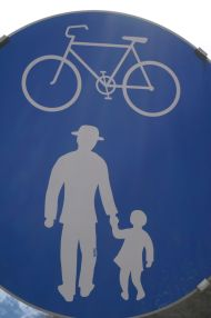A path for bikes, bow-legged girls in short skirts and gentlemen wearing dapper hats