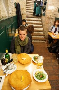 Tourists attempting the famous Wiener Schnitzel from Figlmüller in Vienna