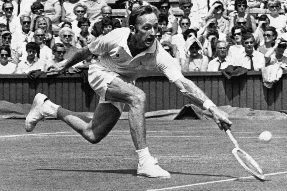 Australian Rod Laver, seeded number one, returns against Jan Leschly of Denmark in play at Wimbledon, June 27, 1969. Laver triumphed, 6-3, 6-3, 6-3. (AP Photo/Bob Dear)