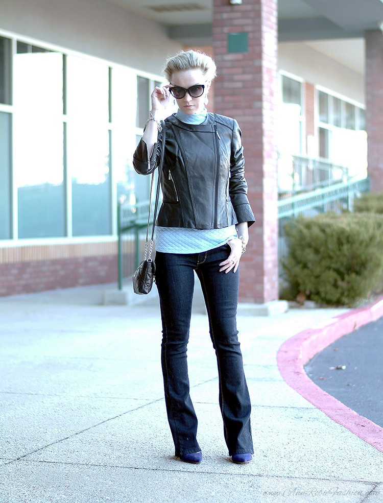 Ann Robie, fashion blogger style: blue quilted top, jeans, black leather jacket, sky blue earrings