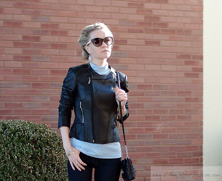 Street style: Ann Robie Fashion style, blue quilted top, jeans, black leather jacket, sky blue earrings