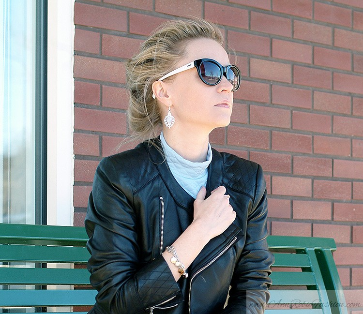 Blogger style: Ann Robie Fashion is wearing blue quilted top, jeans, black leather jacket, sky blue earrings