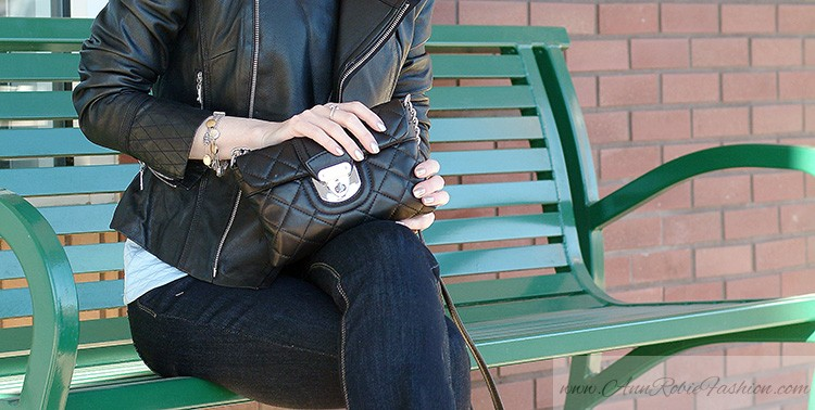 Ann Robie Fashion style details: blue quilted top, jeans, black leather jacket, Calvin Klein quilted purse