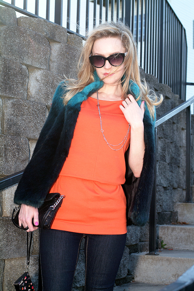 How to wear orange top: Orange Top Jeans and navy blue and turquoise vest