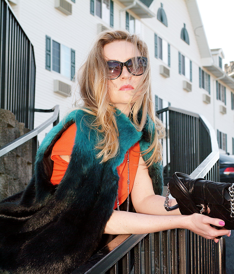 Street Style by Fashion blogger Ann Robie: Orange Top Jeans and navy blue and turquoise vest