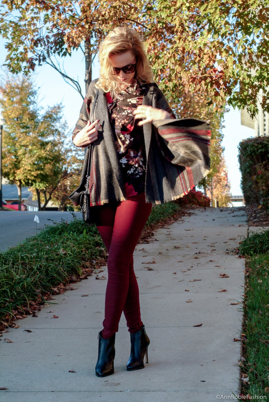 How to wear a blanket scarf if you are petite: burgundy skinny pants Charlotte Russe, floral print shirt Loft, striped blanket scarf, black leather boties Vince Camuto - monochromatic casual outfit by petite style blogger AnnRobieFashion
