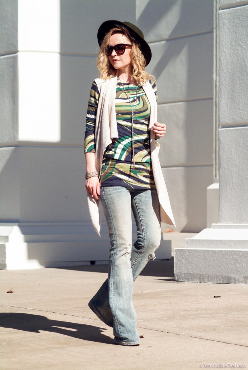 What to wear with a sleeveless cardigan: Sleeveless tan cardigan Ann Taylor, green multi color dress, flared jeans Ralph Lauren, olive green-hat Target - outfit by petite style blogger AnnRobieFashion