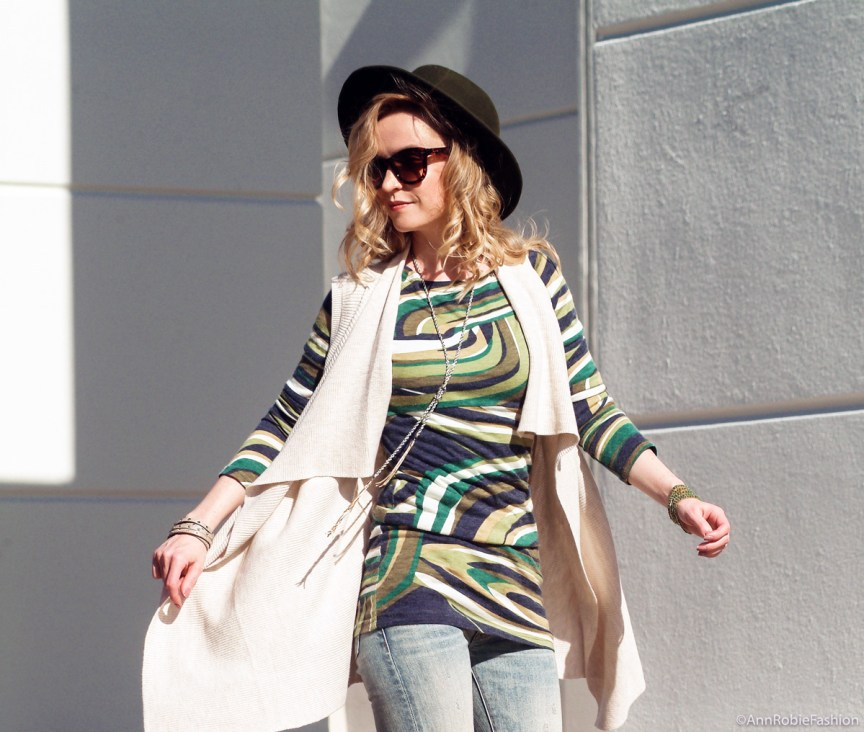 70s: Sleeveless tan cardigan Ann Taylor, green multi color dress, flared jeans Ralph Lauren, olive green-hat Target - outfit by petite style blogger AnnRobieFashion