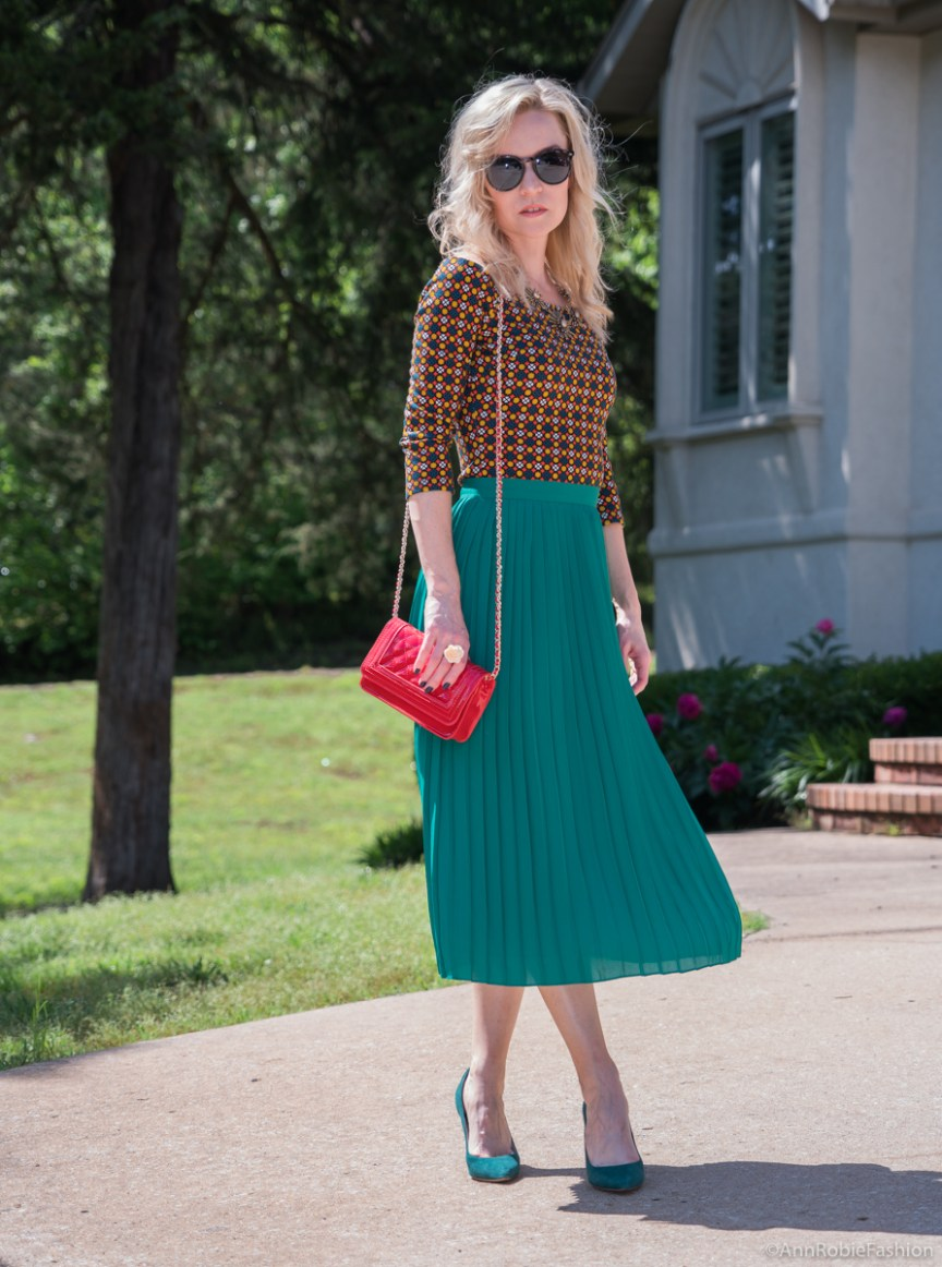 Green midi pleated skirt, off-shoulder top, red cross-body bag - summer outfit by petite style blogger AnnRobieFashion