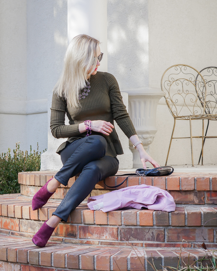 Winter color trend: Dark green peplun top H&M, skinny jeans Ann Taylor, lilac leather jacket WHBM, suede booties Marc Fisher - winter outfit by petite style blogger AnnRobieFashion