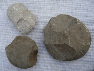 Found at Bronze Age sites, these flaked cobbles may have been used as heavy duty choppers.