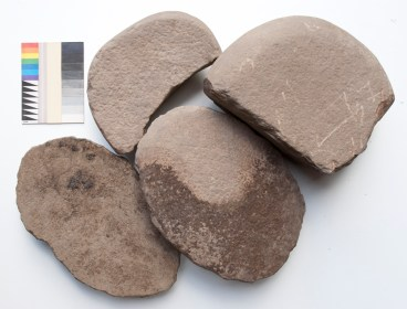 The two quern rubbers at the bottom of the picture are large tools with a classic D-shaped cross-section. Both of the saddle querns at the top of the picture were broken in antiquity.