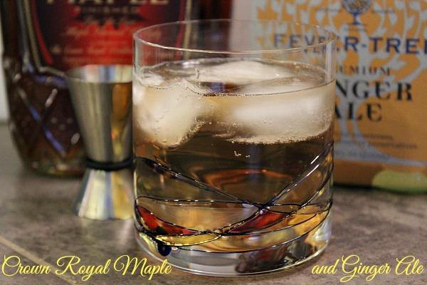 Crown Royal Maple in cocktail glass, garnished with cherry and cucumber