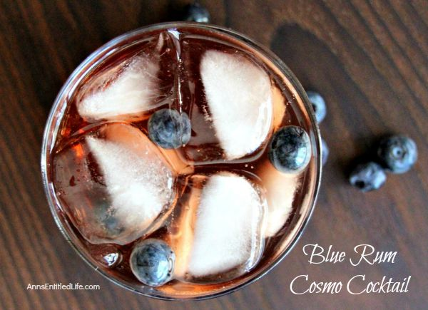 Blue Rum Cosmo Cocktail; a rum take on the traditional cosmopolitan recipe. This easy to prepare blue rum cosmo cocktail will delight your taste buds year round.