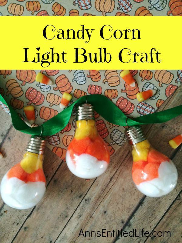 Candy Corn Light Bulb Craft; this super cute candy corn light bulb craft that is easy enough for a child to make (with adult supervision). These candy corn light bulbs can be strung on a ribbon as a banner, hung in a window as décor, or set up in on your table on a dish or nestled in popcorn as a centerpiece!