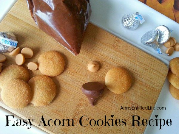 Easy Acorn Cookies Recipe; these easy to make, no-bake, kid friendly Acorn Cookies are a tasty and festive fall treat. Perfect for lunch boxes, snacks or after dinner desserts, these Acorn Cookies are sure to please the entire family.