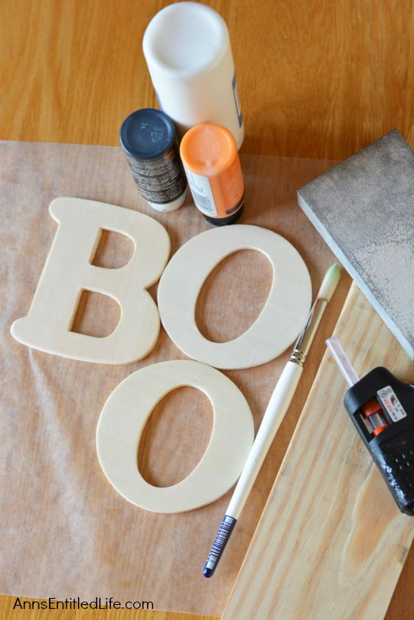 DIY Boo Pallet Project; An easy to make Halloween decoration. Easily, quickly, and inexpensively make this cute Boo Pallet to add to your Halloween mantel display, hang on a door, or prop on a frame on a table.  These simple step by step instructions make this DIY Boo Pallet Project effortless.